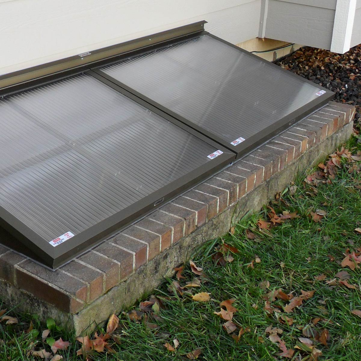 Egress window well covers built by Lustercraft