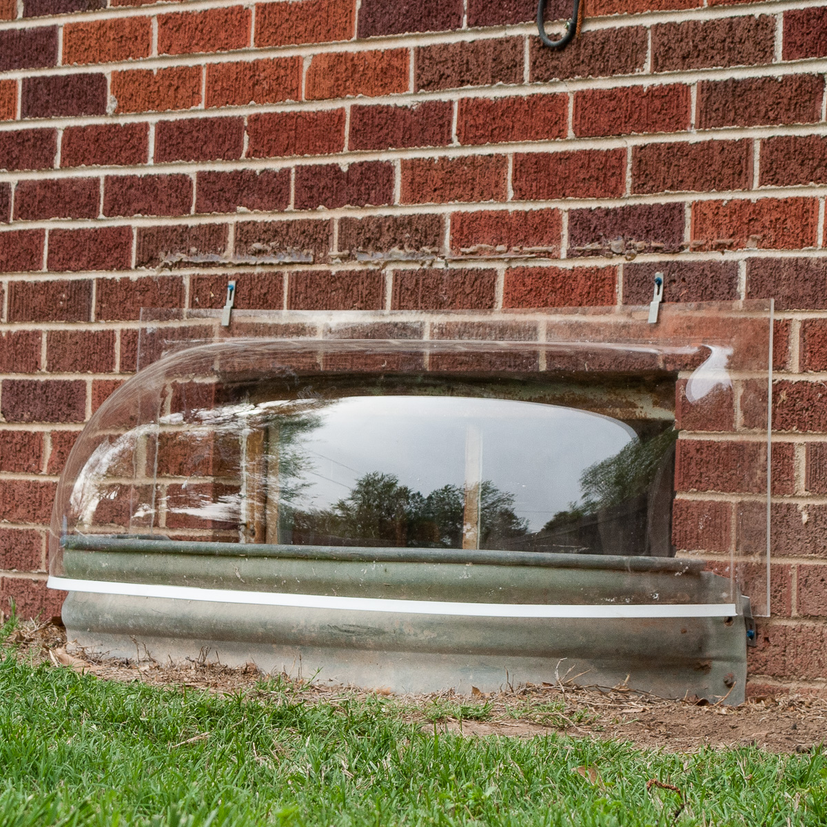 Bubble window well covers by Lustercraft